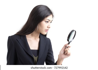 Asian Woman looking something for work, Working woman Concept, Businesswoman using  Magnifying for seaching, isolated on white blackground.
