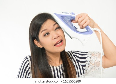 Asian Woman middle age try to use iron to remove wrinkle on face
