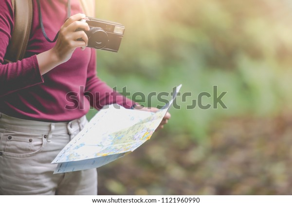 Asian woman is a new traveler that take a photo of mountain veiw on vacation day with backpack