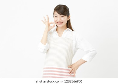 Asian woman OK gesture