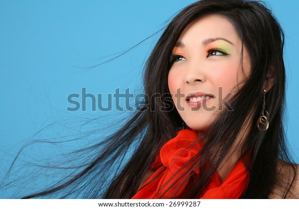 asian woman on blue