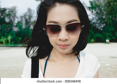 Asian woman on Thailand vacation.