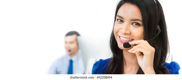 Asian woman as an operator in call center - panoramic banner background with copy space