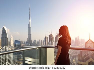 Asian woman overlooking the cityscape of Dubai