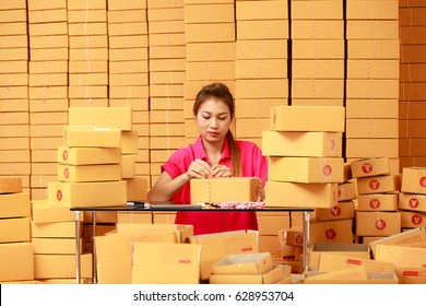 Asian woman packing boxes at home in ecommerce online shopping  business
