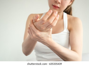 Asian woman pain at wrist, arm and hand, feel ache, Inflammation, woman muscle pain concept