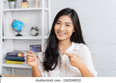 Asian woman paying by credit card at gift shop ,woman hands entering security pin in credit card reader swipe through terminal for payment in booth,buy and sell products service,internet of things
