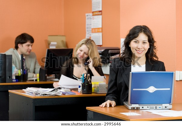 Asian woman with people working in the office