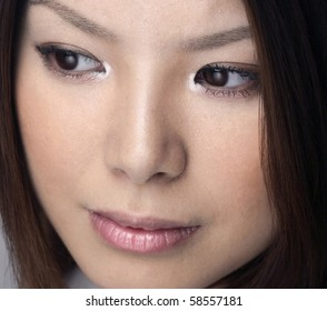 Asian woman photographed indoors.  She was 23 years old at the time of shoot and Japanese.