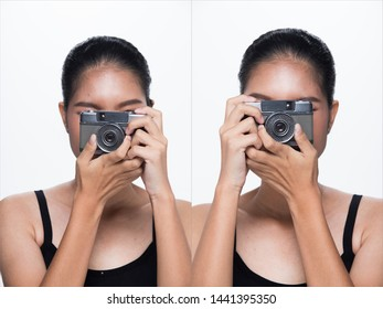 Asian Woman Photographer hold classic compact film camera with  to shoot subject, wear formal gray suit. studio lighting white background isolated copy space, reporter journalist tourist take photo