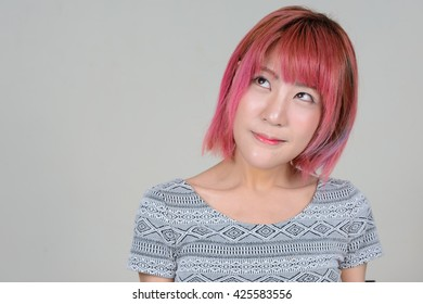 Asian woman pink hair