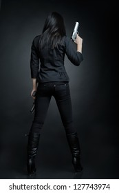 Asian woman with a pistol