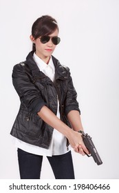 Asian woman with a pistol on white background