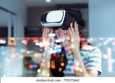 Asian Woman is Playing Virtual Reality Goggles in Library Room, Pretty Woman Using VR Glasses for Entertainment Gaming. Virtual Video 3D Reality Game of Digital Technology Futuristic, Leisure Activity