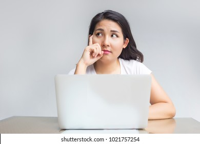 asian woman point up with laptop with thinking idea as startups with digital concept idea to build platform online