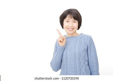 Asian woman pointing side