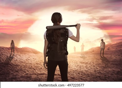 Asian woman police with baseball bat in his shoulder looking at zombies on desert