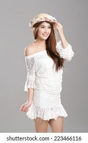 Asian woman posing in Adaptable Strapless Tube Top Slim Long-sleeve One-piece Dresses