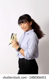 The Asian woman posing on the white background.
