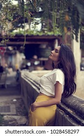 An asian woman posing for a portrait shoot on a river bank in Talad noi, old community, Bangkok, Thailand