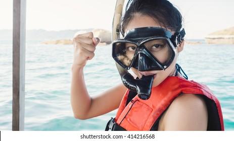 Asian woman prepare for snokeling.