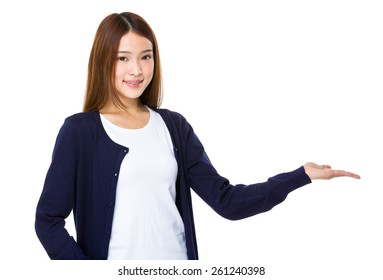 Asian woman present something