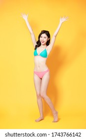 asian woman is relaxed and carefree and ready to travel with bikini swimsuit