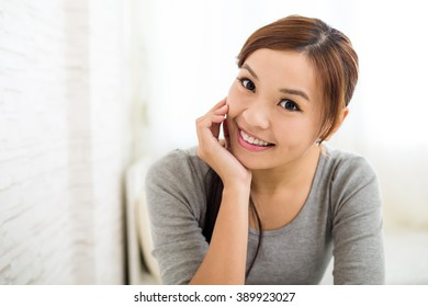Asian woman relaxing at home