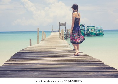Asian woman relaxing on the bridge looking at the sea,koh kood Thailand.
