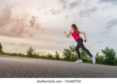 Asian woman runner is running.
