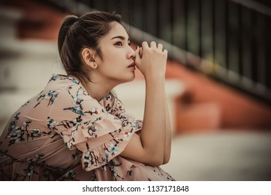Asian woman sad from love,She worry because stress from boyfriend,Heartbreak woman concept,Thailand people