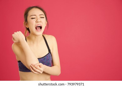 Asian woman screaming after she has grazed and cut her arm