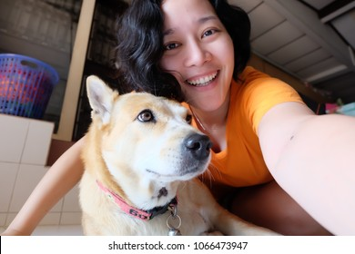 Asian woman selfie with dog