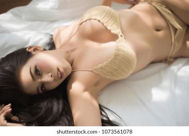asian woman sexy Beige bikini or nude color in room
