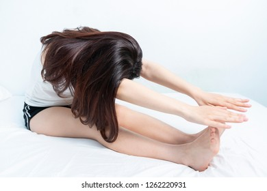 Asian woman shaking stretching and opening her arms to warm up her body