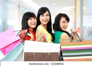 asian woman shopping with friends together isolated on white background