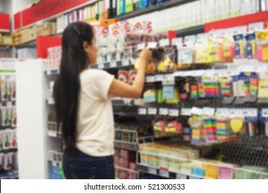Asian woman shopping in stationery store