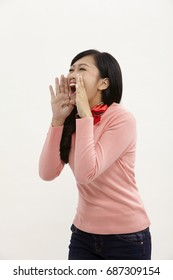 asian woman shouting on the white background