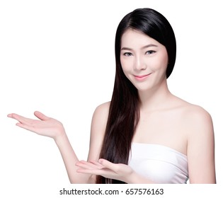 Asian woman showing and presenting copy space with long hair. Natural makeup and beauty face. Isolated over white background.