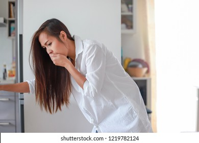 Asian woman sick about throwing up because she pregnant having a morning sickness