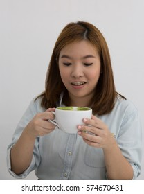 Asian Woman Sipping Cup of Matcha Latte