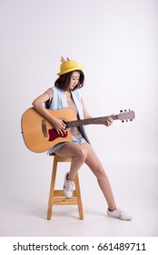 asian woman sit and guitar wtih white background