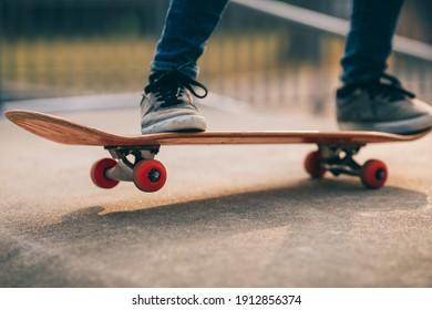 Asian woman skateboarder skateboarding at skatepark
