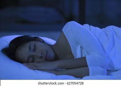 Asian woman are sleeping at night.