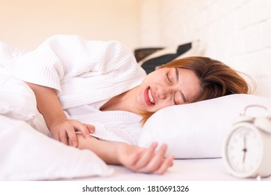 Asian woman sleeping on the bed and grinding teeth,Female bruxism,Gnash or clench your teeth