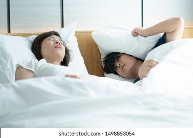An Asian woman sleeps, but she cannot breathe, so she has to open her mouth to help her breath. Sleeping open mouth affects health. Causing snoring and not getting enough sleep.Must consult a doctor
