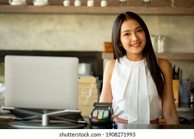 Asian woman small owner business cafe smile and happy with her shop.Successful new opening cafeteria.