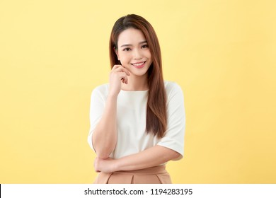 Asian woman smiling with dimple long hair black eyes on yellow background cute nice girl face vintage style Beautiful Asian girl oriental girl black hair long teenager young model student pretty