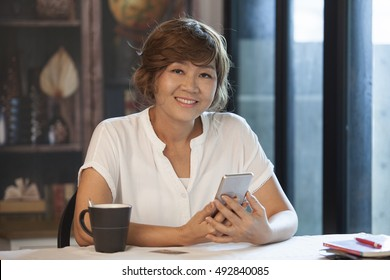 asian woman with smiling face happiness emotion and mobile phone in hand
