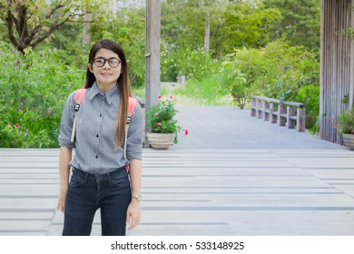 Asian woman smiling happily in the garden.